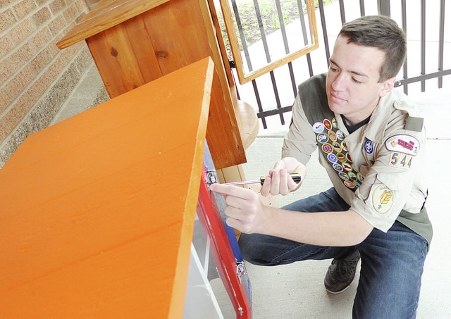 Anthony Weber | Troy Daily News Boy Scout Ian Lyons from Troop 544 located at the Troy Fish and Game assembles a Little Library at the Troy Aquatic Park recently.
