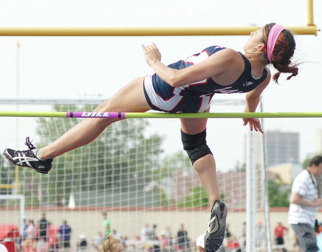 Anthony Weber/Civitas Media Piqua's Ashley Ho goes over the bar in the high jump.