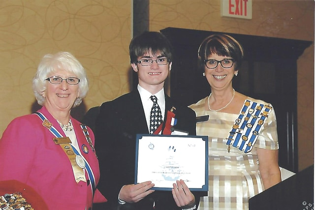 Provided photo Ethan Marsh of Piqua, center, displays his award for placing third in the national level of the Christopher Columbus Essay Contest. He was sponsored by the Piqua-Lewis Boyer Daughters of the American Revolution Chapter. His essay will be published in the national DAR magazine, American Spirit. Marsh is a freshman attending the Great Books Program, Angelicum Academy at Marsh Home School. Above, he is pictured with OSDAR State Regent Sandra McCann, left, and Darlene West, OSDAR American History Committee Chairman.