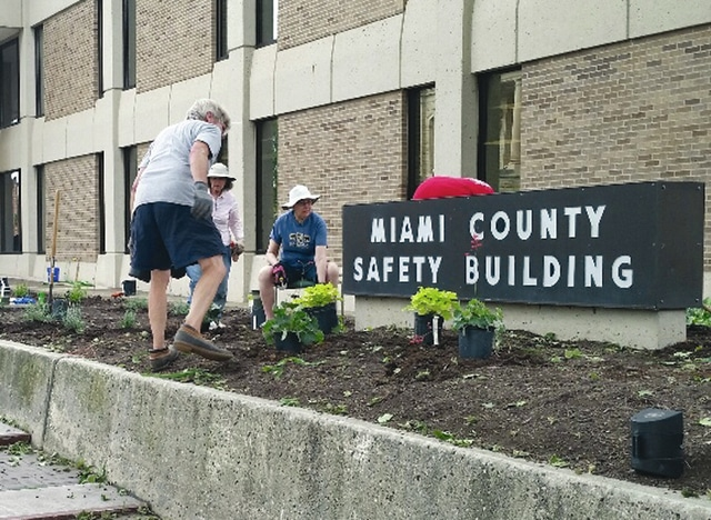 Provided photo Master Gardener volunteers work on the flower bed at the Miami County Safety Building