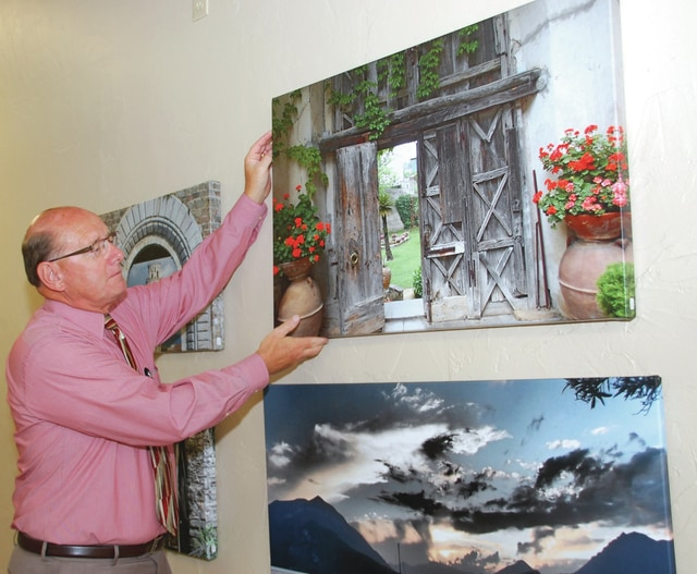 Provided photo Retiring UVMC respiratory therapist Jerry McGlothen with some of his work.