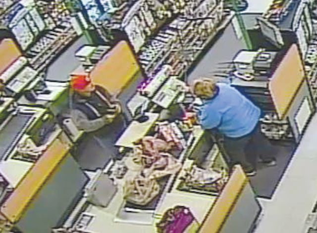 Photo released by the Piqua Police Department of the alleged suspect using a stolen card at Kroger on Monday. Those who recognized the man in the red cap are asked to contact Piqua police. Use Submit-A-Tip to remain anonymous and possibly qualify for a reward, or call Officer Lloyd at (937) 778-2027 ext. 3018.