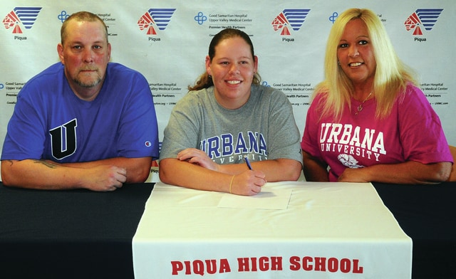 Mike Ullery/Daily Call Cassidy Kraft signs her letter of intent to play golf for Urbana University. Shown with Kraft are her parents Brian Branson and Shelby Kraft.