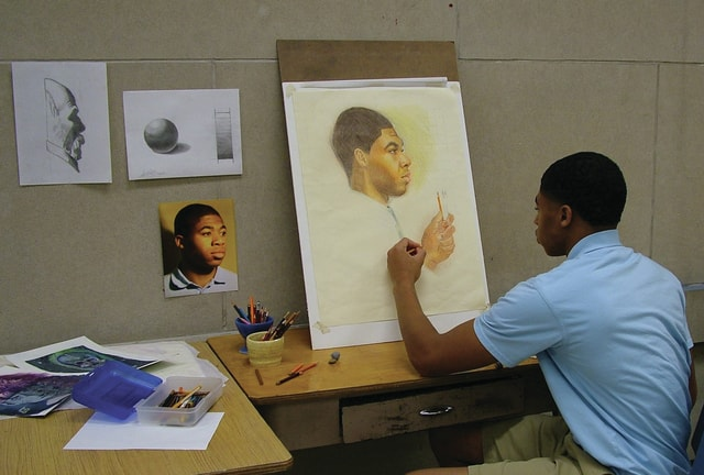 Provided photo Seth Brown, a junior at Lehman Catholic High School and the son of Alice Brown of Sidney, works on a self-portrait to be displayed at Taste of the Arts, which takes place May 20, in Piqua. Creations by area students will be part of the Student Art Exhibit held in conjunction with Taste of the Arts. In addition, the exhibit will run through May 23 on the second floor of the Apple Tree Gallery in downtown Piqua.