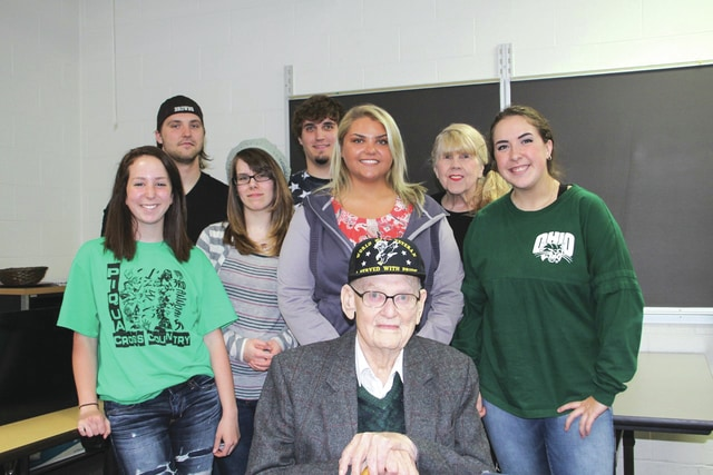 "Provided photo World War II U.S. Army veteran Capt. Robert Tweed of Troy recently related his experiences at the Battle of the Bulge and Dachau to American literature students at Edison State Community College. Pictured with Capt. Tweed are, left to right, front row: Gabby Knouff, Jessie Jones, Mindy Bach, Savannah Harvey; second row: Jon Dembski, Jesse Wall, faculty Vivian Blevins. The students are studying ""Maus,"" a Nobel Prize-winning graphic novel about the Holocaust."