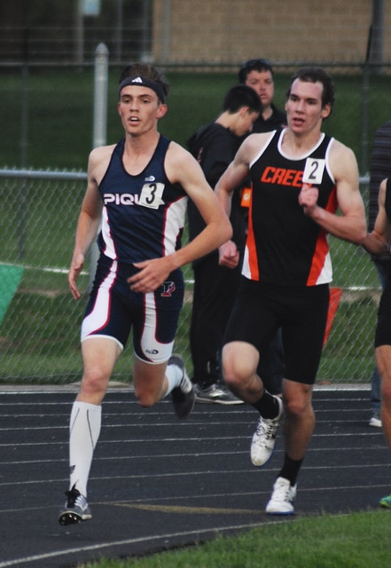 Rob Kiser/Call Photo Piqua's Andy Mayse leads Beavercreek's Ben Ewert in the 3,200 Friday at Troy Memorial Stadium at the GWOC All-Star meet.