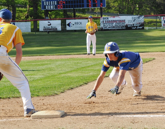 Rob Kiser/Call Photo Lehman's Brandon Barhorst dives back into first base Wednesday