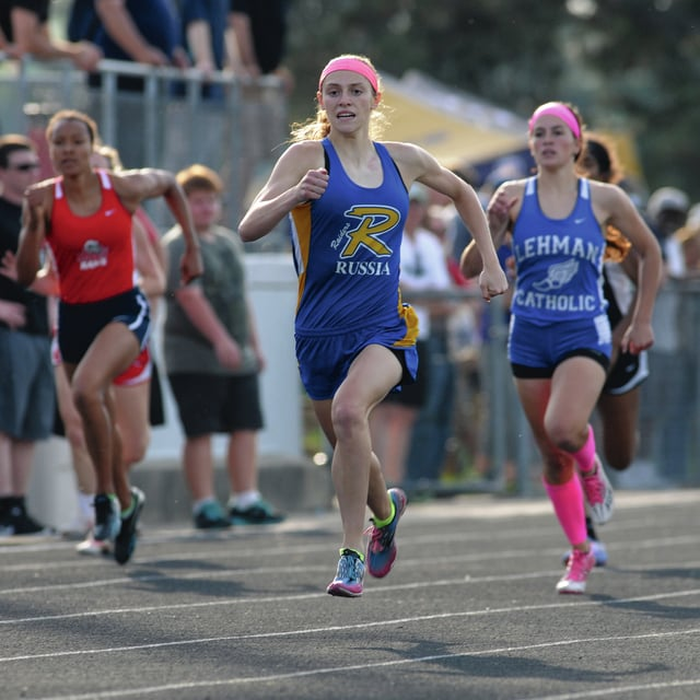 Ben Robinson/GoBuccs.com Lauren Heaton and Alanna O'Leary lead the way in the 400 Friday night at the Troy D-III regional.