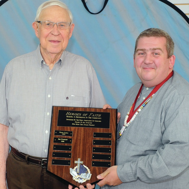 Mike Ullery | Daily Call Don Wagstaff (left), former pastor of the Piqua Church of the Brethren, with Paul Green (right), president of the Piqua Association of Churches. Wagstaff is the second community member to be honored with Heroes of Faith Award.