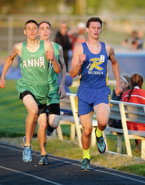 Ben Robinson/GoBuccs.com Russia's Caleb Ball leads the way in the 800-meter run Friday at the Covington Invitational.