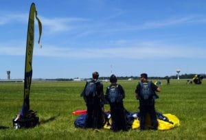 The United States Navy Leap Frogs parachute team performs at the 2016 Vectren Dayton Air Show.