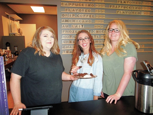 Sharon Semanie | For the Daily Call Left to right, Turntable Cafe owner Kelsey McDowell, and employees Katie Sebring and Rhonda Kniess, display some of the fare offered at the new gourmet coffee and specialty baked goods shop, located at 122 W. High St. in downtown Piqua