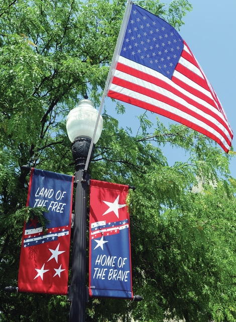 "New patriotic banners can be seen throughout the downtown area of Piqua, just in time for Piqua's downtown July 4th celebration. Banners stating ""Land of the Free"" and ""Home of the Brave"" are up, thanks to the Mainstreet Piqua Beautification Committee."