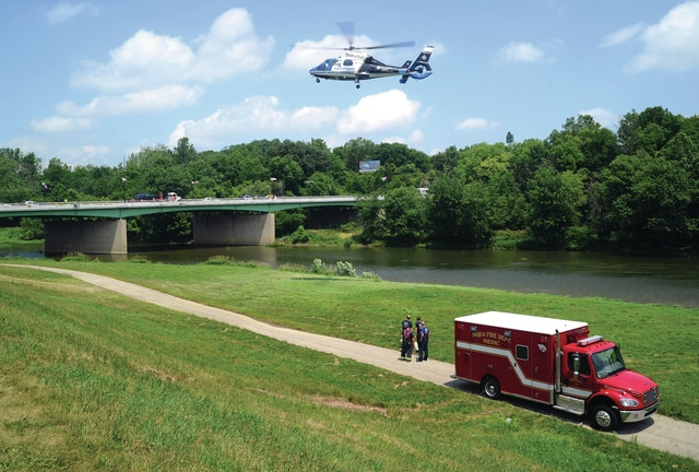 Mike Ullery | Daily Call CareFlight lifts off to transport a man who was pulled from the Great Miami River in Piqua following an apparent suicide attempt on Thursday afternoon.