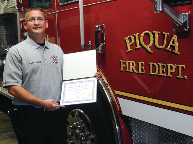 Mike Ullery | Daily Call Piqua Fire Department Assistant Chief Chad Kennedy poses with his diploma from Ohio Fire Chief's Association Fire Executive Program.
