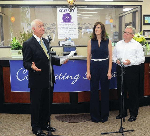 Mike Ullery | Daily Call Jim Gover, Sr., consultant for Main Optical introduces owners Jon and Lori Frank to guests as the business celebrated 55 years of serving customers in downtown Piqua with an open house on Saturday.