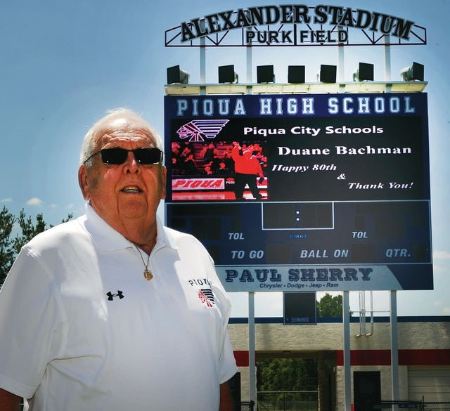 Mike Ullery | Daily Call Former Piqua City Schools superintendent and long-time Voice of the Piqua Indians on WPTW radio and at Garbry Gymnasium, Duane Bachman stopped in at Alexander Stadium/Purk Field to check out the scoreboard message wishing him a happy 80th birthday. Wednesday in Piqua was also officially Duane Bachman day as the community showed their appreciation for the many things Bachman has contributed over his long and distinguished career.