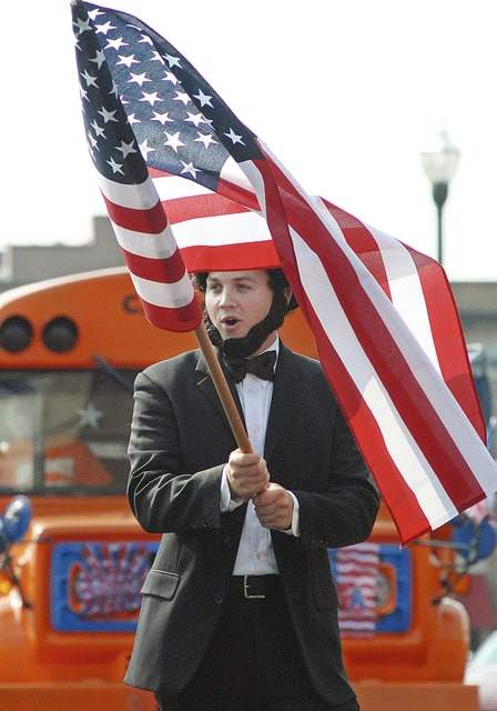 Anthony Weber | Troy Daily News Chris Jordan from Summit Holiness Tabernacle, portrayiing Abe Lincoln, shares a message with parade-goers in downtown Troy during the 2015 Fourth of July parade.