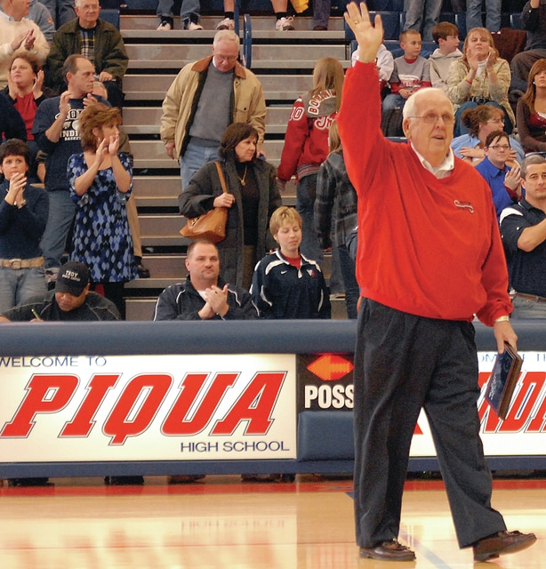 """Staff Photo/Mike Ullery Long-time """"Sports Voice of Miami County"""", Duane Bachman, waves to the crowd after being honored for his many years of service. Bachman, who retired from his second career as WPTW radio's sports voice was superintendant of Piqua City Schools for many years as well."""