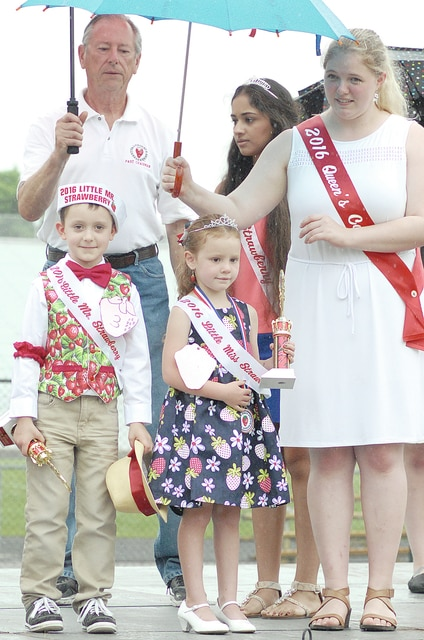 Anthony Weber | Troy Daily News The Troy Strawberry Festival Committee announced its 2016 Little Miss and Mr. Strawberry winners Saturday afternoon near Troy Memorial Stadium. Little Mr. Strawberry is Liam Edwards, 5, son of Tyler and Brittany Edwards of Troy, and Little Miss Strawberry is Elizabeth Marie Sowers, 4, daughter of Adam and Staci Sowers of West Milton. Sowers was also recognized for best costume.