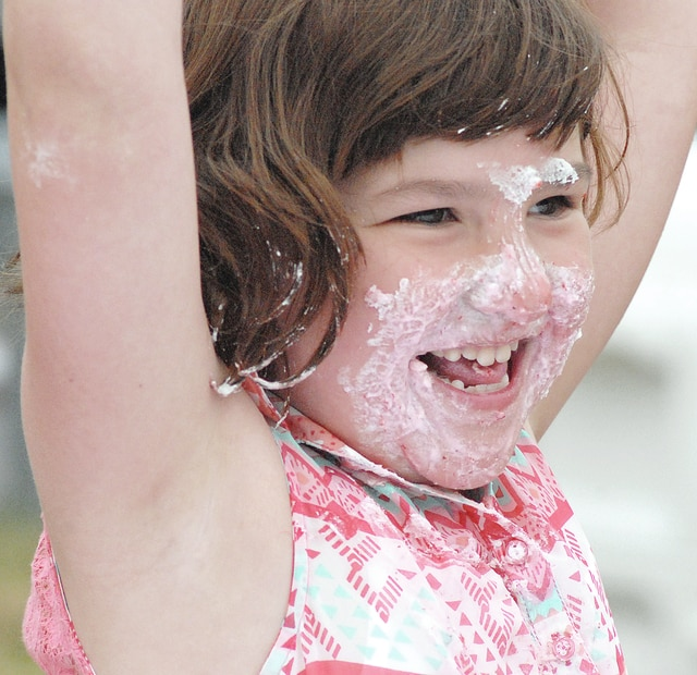 Anthony Weber | Troy Daily News Charlotte Nowlin, 7, daughter of Laura Nowlin of Beavercreek, won the first heat of the pie eating contest on the flood plain of near the Great Miami River on Saturday during the 40th annual Troy Strawberry Festival. Nowlin said it was their first time visiting the festival. For more photos from the festival, see page B1.
