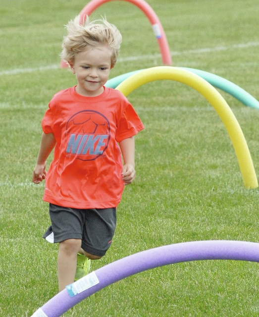 Anthony Weber | Civitas Media Kaesen Gibson, 3, son of Tom and Sara Gibson, competed in the 3- and 4-year-old heat of the Super Kids on Sunday during the 2016 Troy Strawberry Festival at Troy Memorial Stadium.