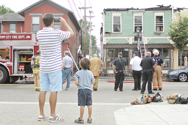 Anthony Weber | Troy Daily News A fire rekindled early Tuesday morning at Browse Awhile Bookstore, 118 East Main Street, downtown Tipp City early Tuesday morning.