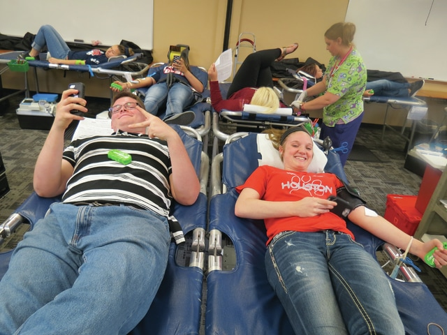 Provided photo Upper Valley Career Center students Carl Lankford and Allison Smith participate in the school's final blood drive of the 2015-16 school year for the Community Blood Center.
