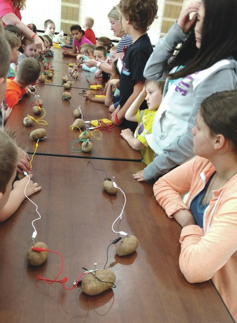 Provided photo Students of the summer STEM camp at Springcreek Primary School recently learned about electricity by building a potato battery. Representatives from Piqua Electric also spoke to the young campers about electric safety and renewable energy sources.