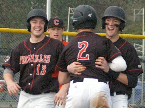 Versailles baseball players (l-r) Adam Lyons, Cole Niekamp and Brett McEldowney celebrate the Tigers' victory against Coldwater on April 28 in Versailles. Versailles hopes for a couple more celebrations at this week's Ohio High School Athletic Association state tournament.