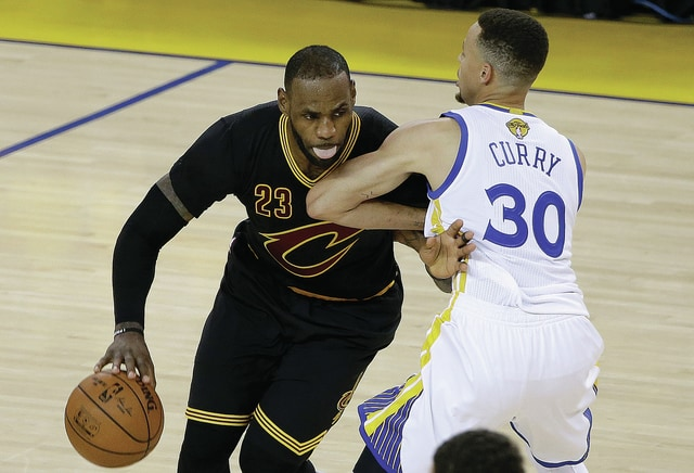 AP Photo Cleveland Cavaliers forward LeBron James (23) dribbles against Golden State Warriors guard Stephen Curry (30) during the second half of Game 5 of basketball's NBA Finals in Oakland, Calif., June 13, 2016. Fifteen years earlier, James — then a sophomore at Akron St. Vincent-St. Mary High School — took on Miami East on the Division III state title game.