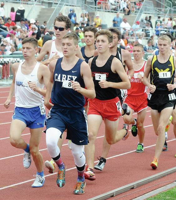 Rob Kiser/Call Photo Brady McBride runs in a pack of runners Saturday in the Division III 3,200-meter run.