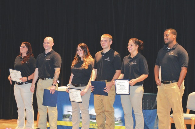 Provided photo Left to right, Sarah Wise, Seth Victor, Elizabeth McGuire, Christian Lovett, Ashley Dillman, and Gary Amlin recently graduated Edison State Community College's Peace Office Academy.