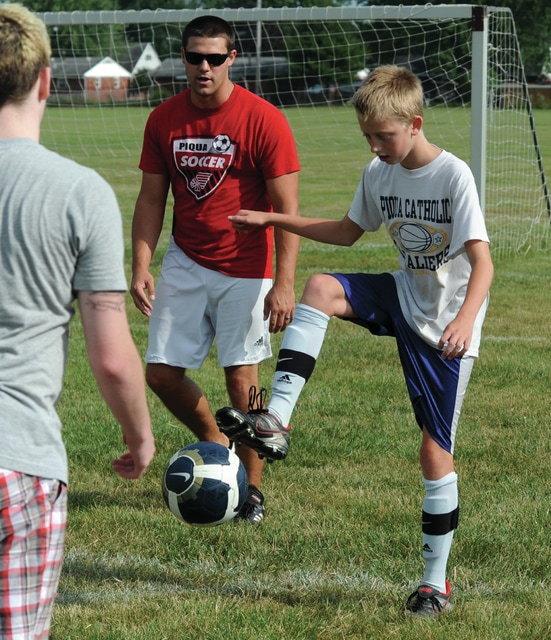 Mike Ullery | Daily Call Coach Danny Henry watches as Andrew Hohlbein, 12, works on a ball-control drill at Pitsenbarger Park on Thursday.