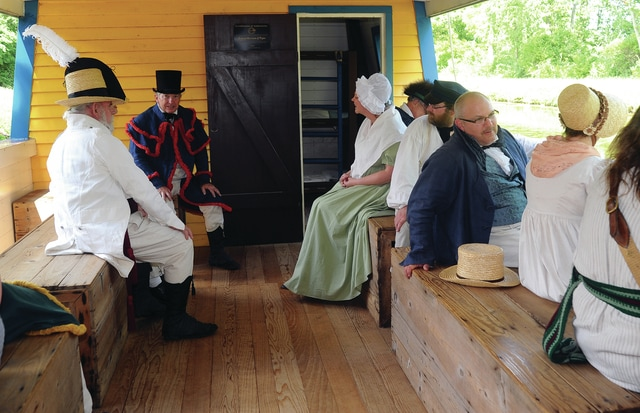 Mike Ullery | Daily Call Members of the 1st Regiment of Volunteers, War of 1812, reenactment group, enjoy at trip aboard the General Harrison on the Miami & Erie Canal during History Alive! at the John Johnston Farm & Indian Agency on Saturday.