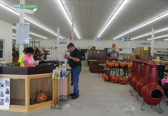 Mike Ullery | Civitas Media ReStore volunteers assist a customer at the newly opened location at 1491 W. Main St., Troy.