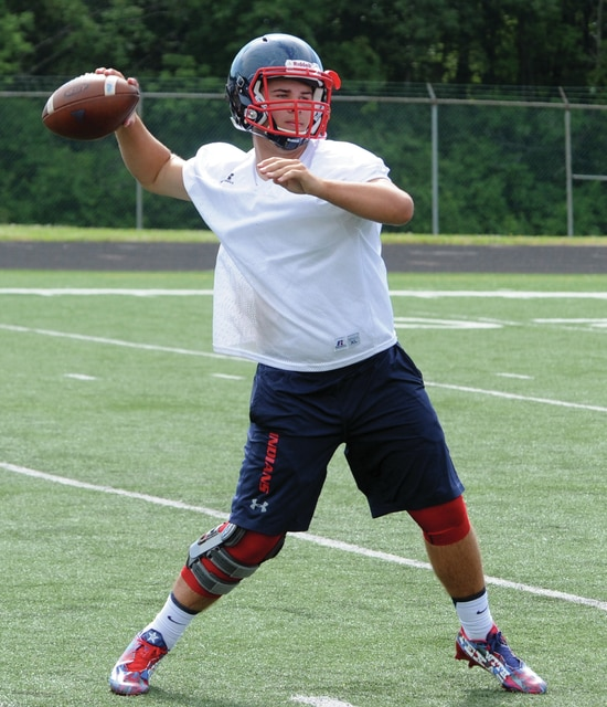 Mike Ullery | Daily Call Piqua quarterback Austin Davis, 3, looks to fire a pass.