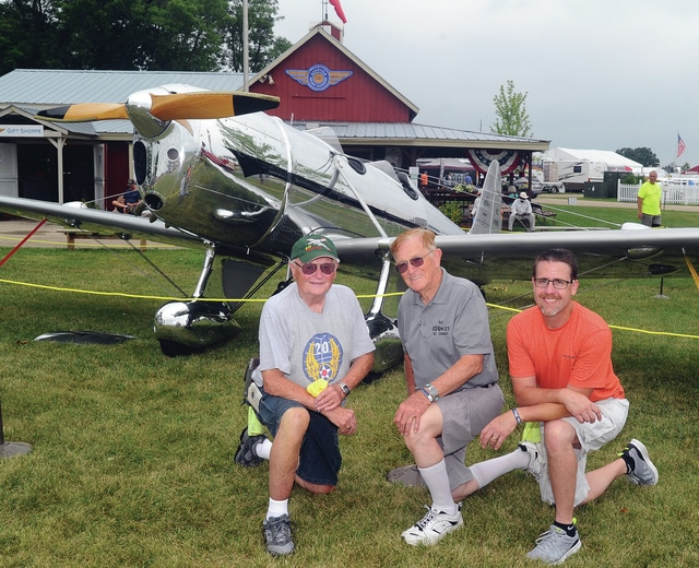 Mike Ullery | Daily Call Bob Jacoby, of Piqua, Ted Teach of New Carlisle, and Doug Smith, of Sidney, l-r, pose with Teach's 1935 Ryan ST aircraft at AirVenture 2016 in Oshkosh, Wisconsin. Teach, Jacoby, and Smith have spent ten years restoring this one-of-a-kind vintage aircraft to flying condition.