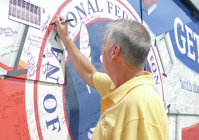 """Anthony Weber   Civitas Media The National Federation of Republican Womens Red, White and Blue bus """"Rosie"""" visited Troy Friday afternoon at the Club 55 parking lot. Members of the community stopped by to visit with NFRW representatives who are traveling across Ohio and the rest of the nation to promote the right to vote and help unify the party. Folks who stopped by had a chance to meet NFRW President Carrie Almond and sign the bus as Chief Deputy Dave Duchak of the Miami County Sheriff's Office had done. """"We'd like to keep rolling until November,"""" Almond said. The NFRW would like to remind voters if you've moved, you'll need to re-register and that individuals may register if they will be 18 by November."""
