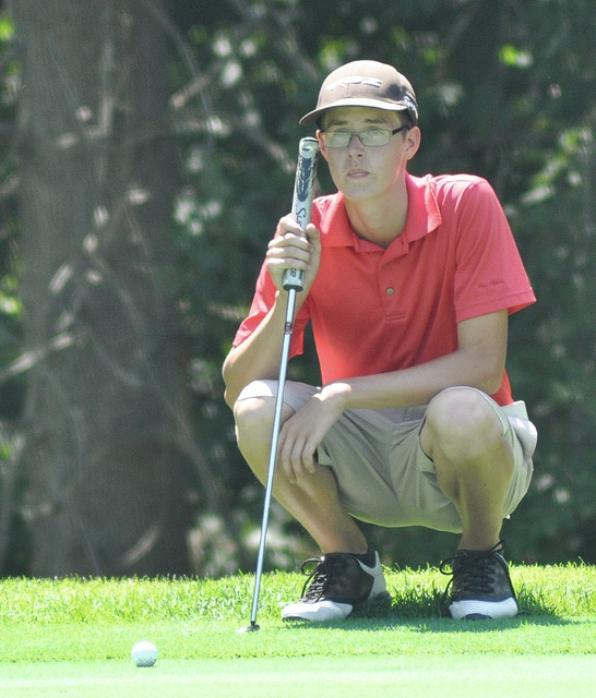 Rob Kiser/Call Photo Andrew Slusher looks over a putt from the back of the 10th green Wednesday at Echo Hills.