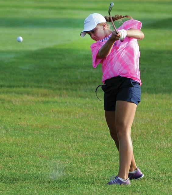 Mike Ullery | Daily Call Piqua's Kelsey Bachman hits an approach shot at Echo Hills on Wednesday during the annual Lady Buccs Pink Out Golf Tournament.