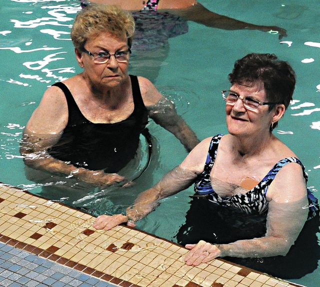 Mike Ullery | Daily Call Jackie Jenkins, 87, of Troy, and Aundalee Wintrow, 75, of Piqua, participate in the Arthritis Aquatic Program at the Piqua Branch of the Miami County YMCA on Wednesday.