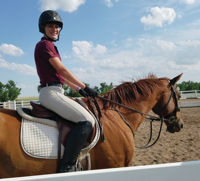 Provided photo Miami East High School student Lorenza Savini sits atop her horse, George of the Jungle, whom she rides when she competes in the modern pentathlon. Savini recently traveled to Limerick, Ireland to compete in the Youth World Championships.