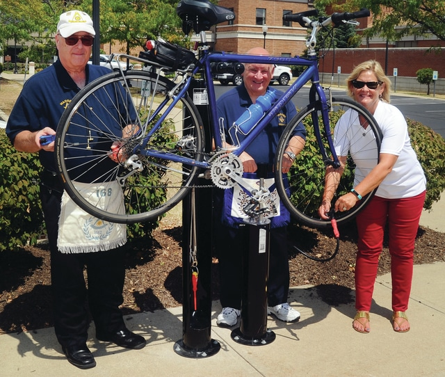 Mike Ullery | Daily Call Mike O'Donnell and Stu Shear of Warren Lodge #24 of the F&AM of Ohio are joined by Piqua Mayor Kazy Hinds to demonstrate the city's new Fix-It Bike Repair Station, located on the bike path, directly behind the Piqua city building. The station was funded by a grant from the Piqua Community Foundation, private donations, and Warren Lodge #24. The station provides an air pump and a variety of bicycle repair tools to provide cyclists with a convenient spot for bicycle repairs and maintenance.