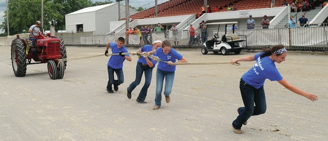 Mike Ullery | Civitas Media Jarrett Winner, Cadence Gross, Lauren Wright, and Katelynn Wallace, all 13 and from Miami East participate in the Human Tractor Pull event at the Miami County Fair on Saturday.