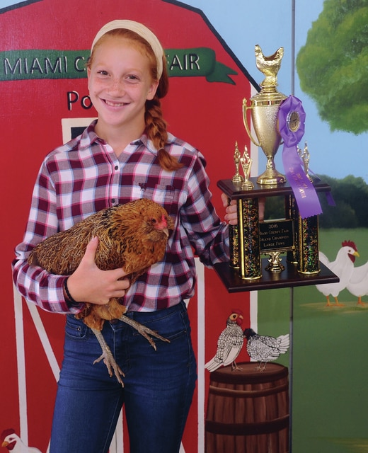 Emma Patzek, 12, of Tipp City won Grand Champion Large Fowl. Patzek is a member of the Just 4 Fun 4H Club.