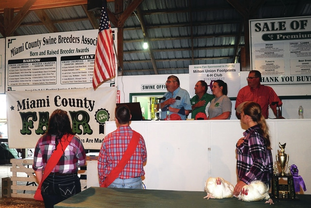 Mike Ullery | Daily Call The Sale of Champions kicks off at the 2016 Miami County Fair on Wednesday with all in attendance joining together to sing The Star Spangled Banner.