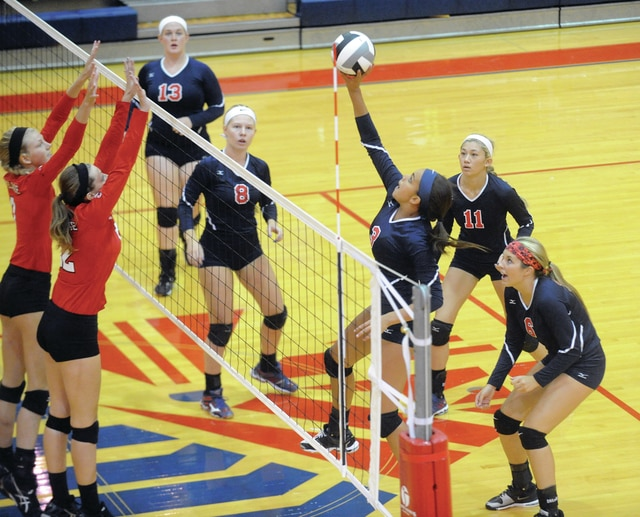 Mike Ullery | Daily Call Tylah Yeomans hits the ball over the net for the Indians as teammates Mikayla Schaffner, 13, Lauren Williams, 8, Ashley Ho, 11, and Ashley Brading, 6, get set for a possible return shot.