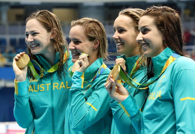 Australia's Cate Campbell, Bronte Campbell, Emma McKeon and Brittany Elmslie, from left, hold their gold medals after winning the women's 4x100-meter freestyle final setting a new world record during the swimming competitions at the 2016 Summer Olympics, Saturday, Aug. 6, 2016, in Rio de Janeiro, Brazil. (AP Photo/Lee Jin-man)