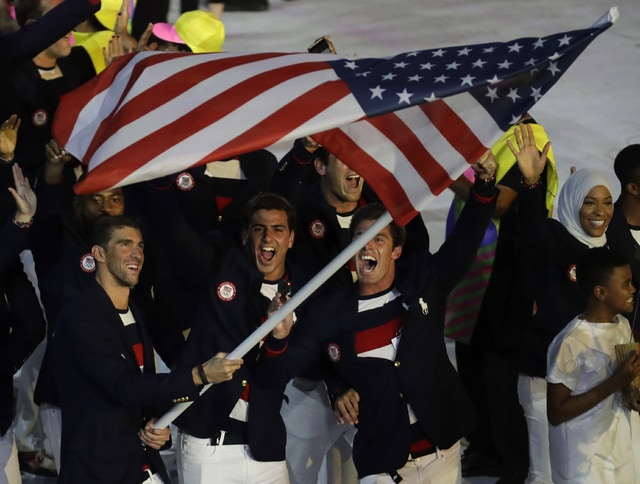 Michael Phelps carries the flag of the United States during the opening ceremony for the 2016 Summer Olympics in Rio de Janeiro, Brazil, Friday, Aug. 5, 2016. (AP Photo/Patrick Semansky)